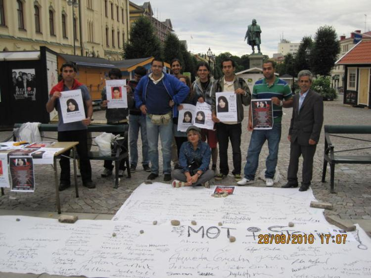 Mohammad Mehdi Maleki (blue and green striped shirt) joins other activists for the 100 Cities Against Stoning international protests to protest against the barbarity of the Islamic Republic of Iran, August 28, 2010